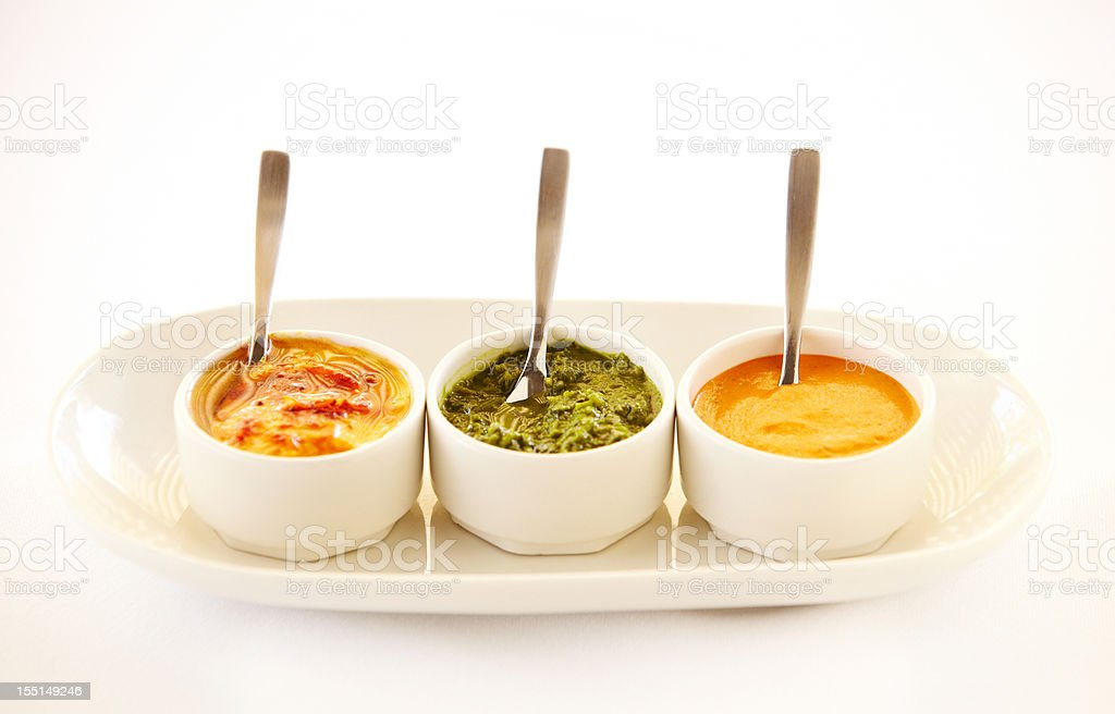 Three bowls of different dips in a row royalty-free stock photo