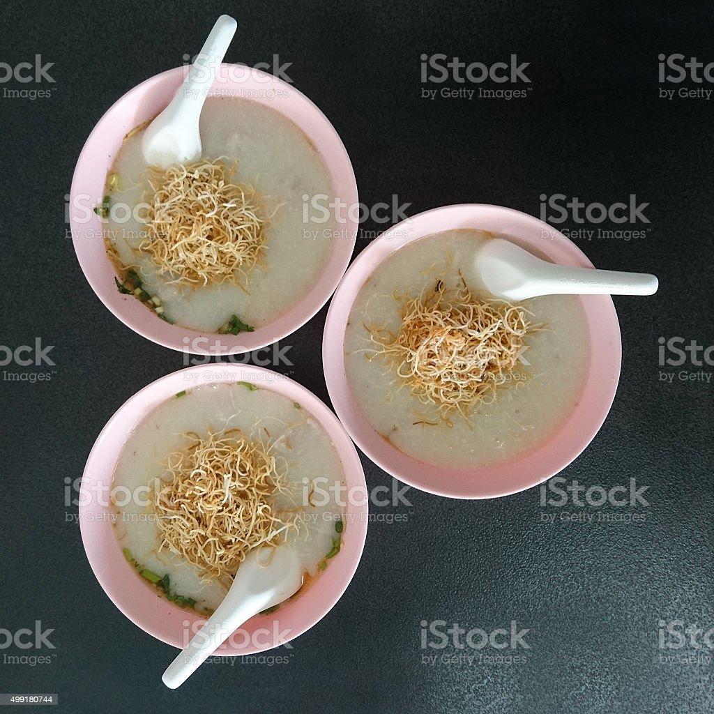 Three bowls of Thai rice porridge with pork. stock photo