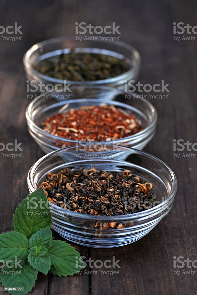 Three bowls with assorted tea leaves stock photo