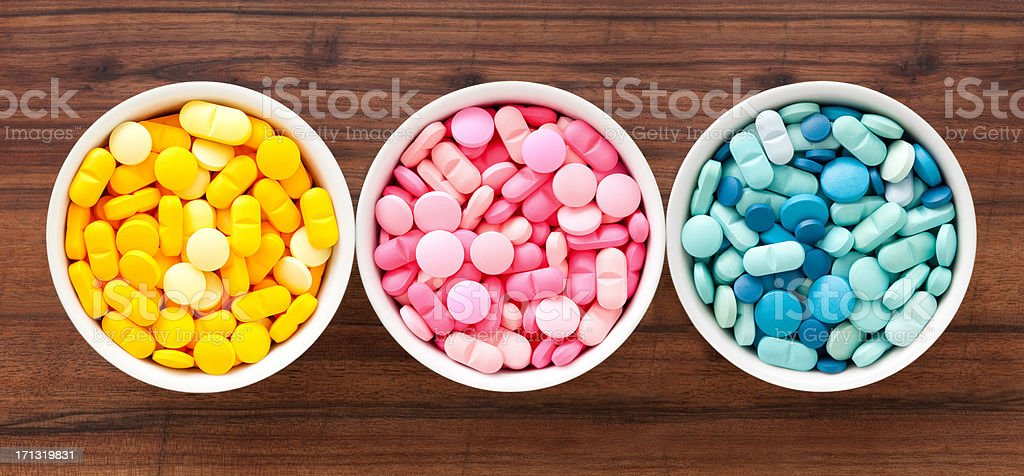 Three bowls with pills royalty-free stock photo