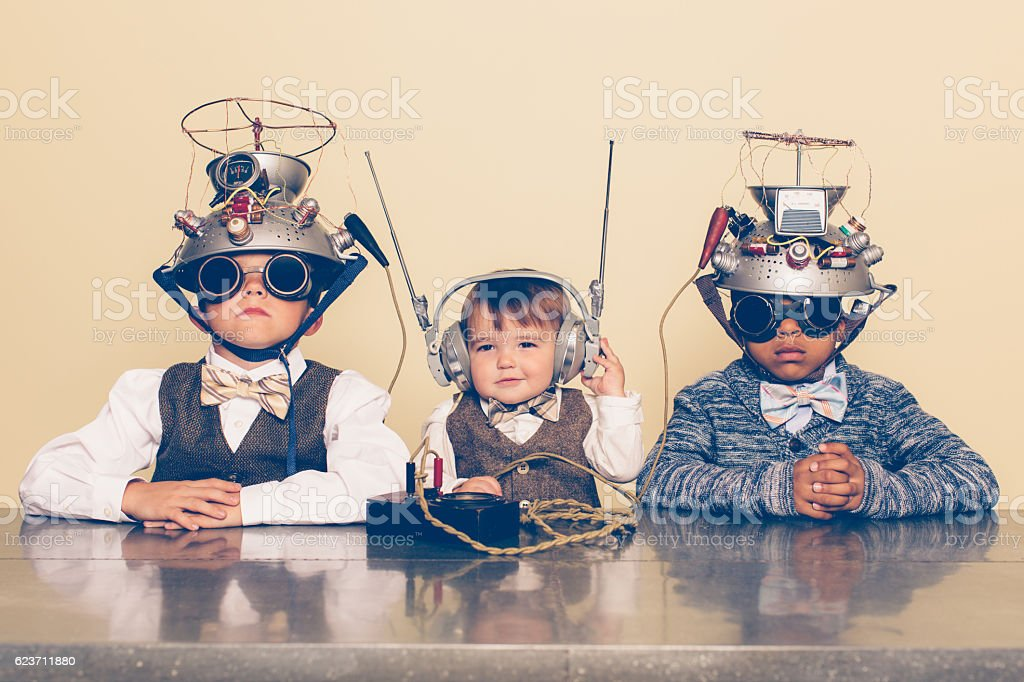 Three Boys Dressed as Nerds with Mind Reading Helmets stock photo