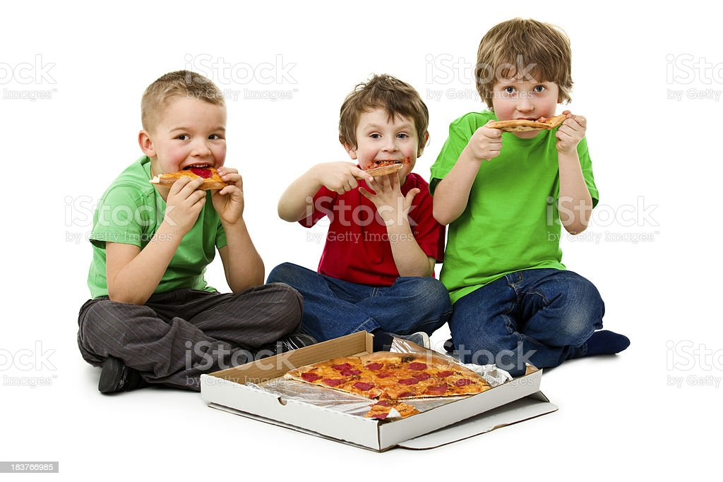 three boys eating pizza royalty-free stock photo