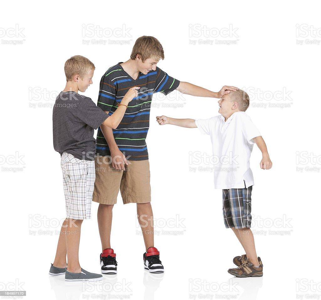 Three boys playing royalty-free stock photo