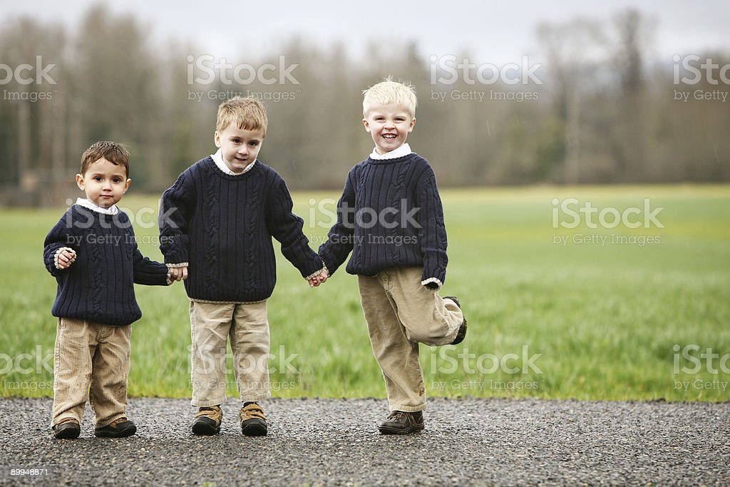 Three Boys Posing for Brother Portrait stock photo