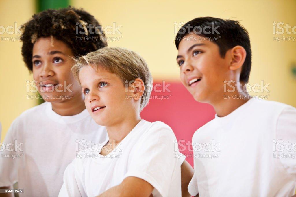 Three boys wearing white t-shirts stock photo