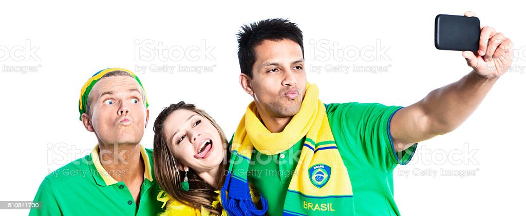 Three Brazilian sports fans making silly Selfie faces stock photo
