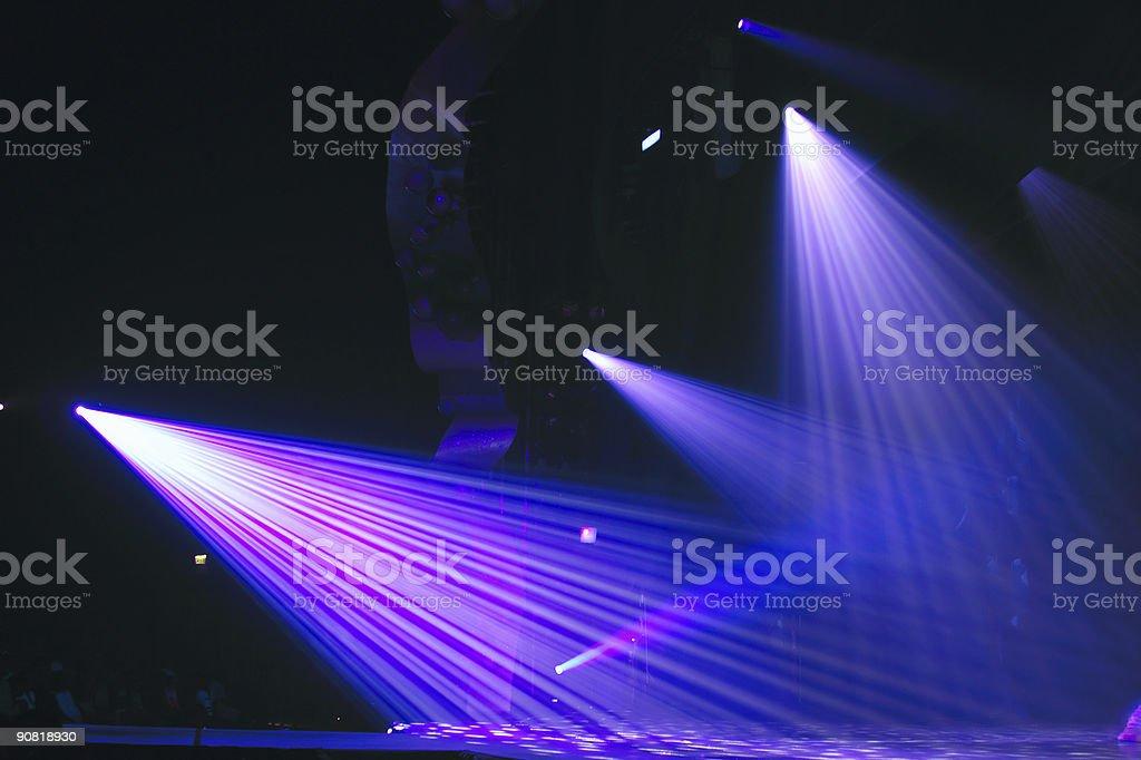 Three bright purple spot lights beaming down stock photo