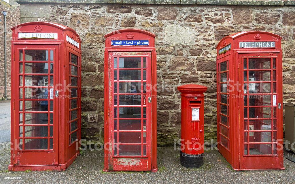 Three British Phone Boxes and a Royal Mail Box royalty-free stock photo