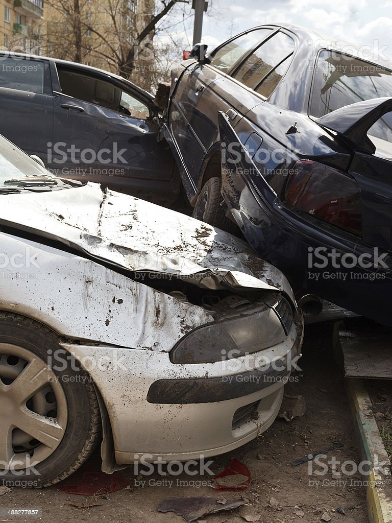 three broken cars during road accident stock photo