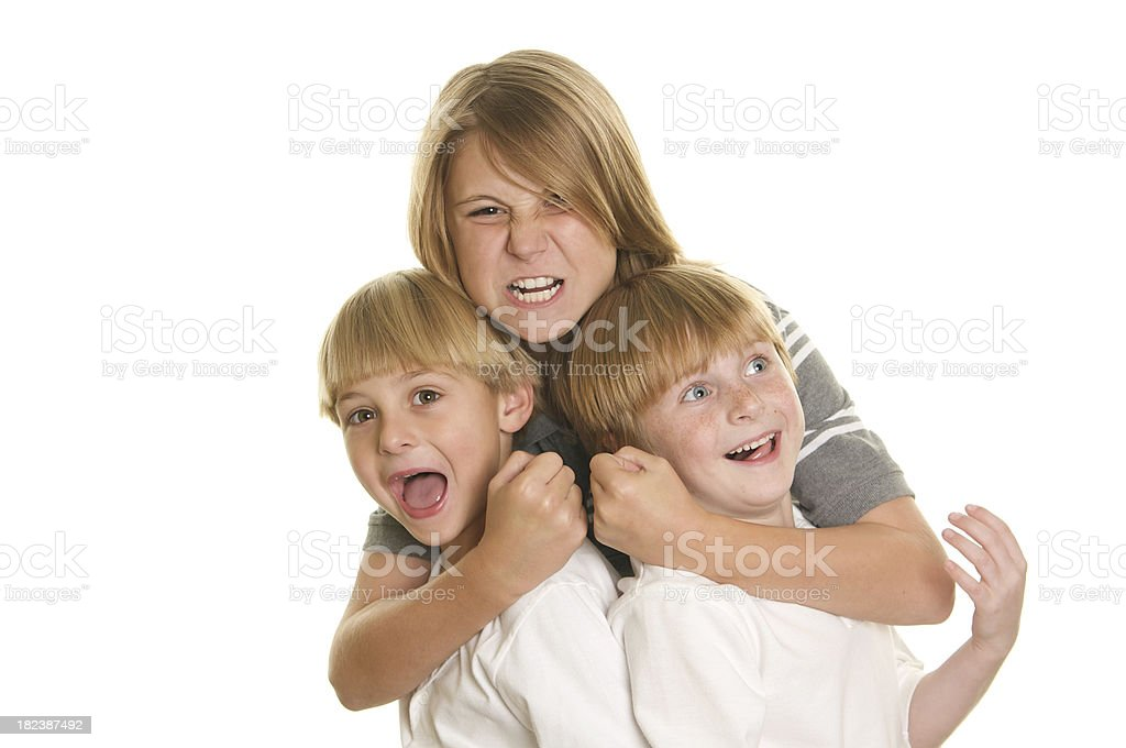 Three Brothers Acting Silly on White Background royalty-free stock photo