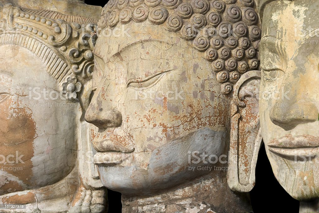 Three Buddha Faces in a Row royalty-free stock photo