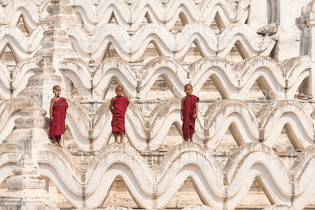 Three Buddhist novices stock photo