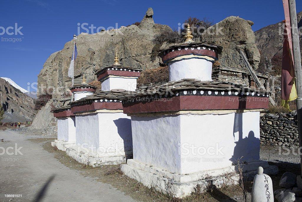 Three buddhist stupas, roadside in Manang, Nepal. royalty-free stock photo