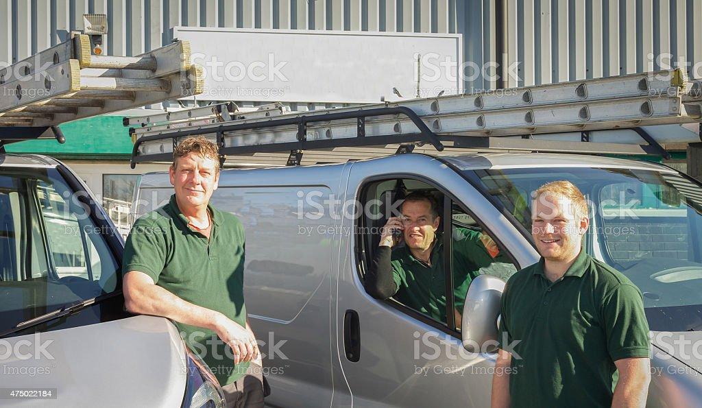 Three builders aerial engineers preparing for work stock photo
