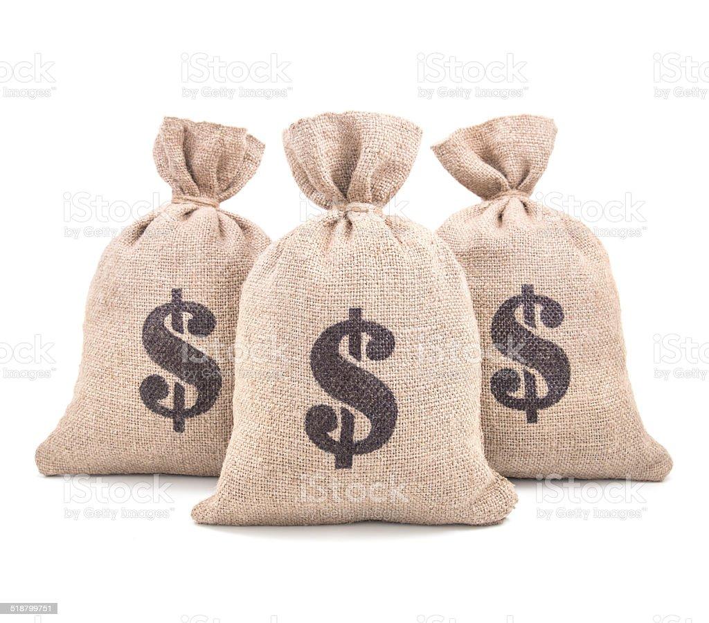 Three burlap money bags isolated on white background stock photo