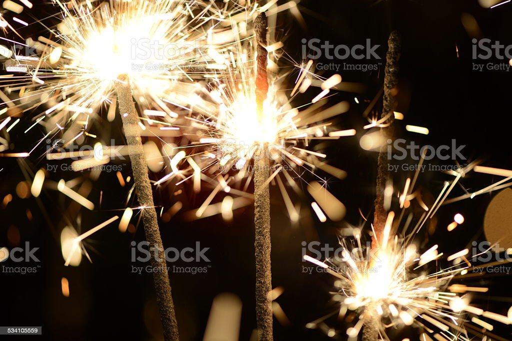 Three burning christmas sparklers. stock photo