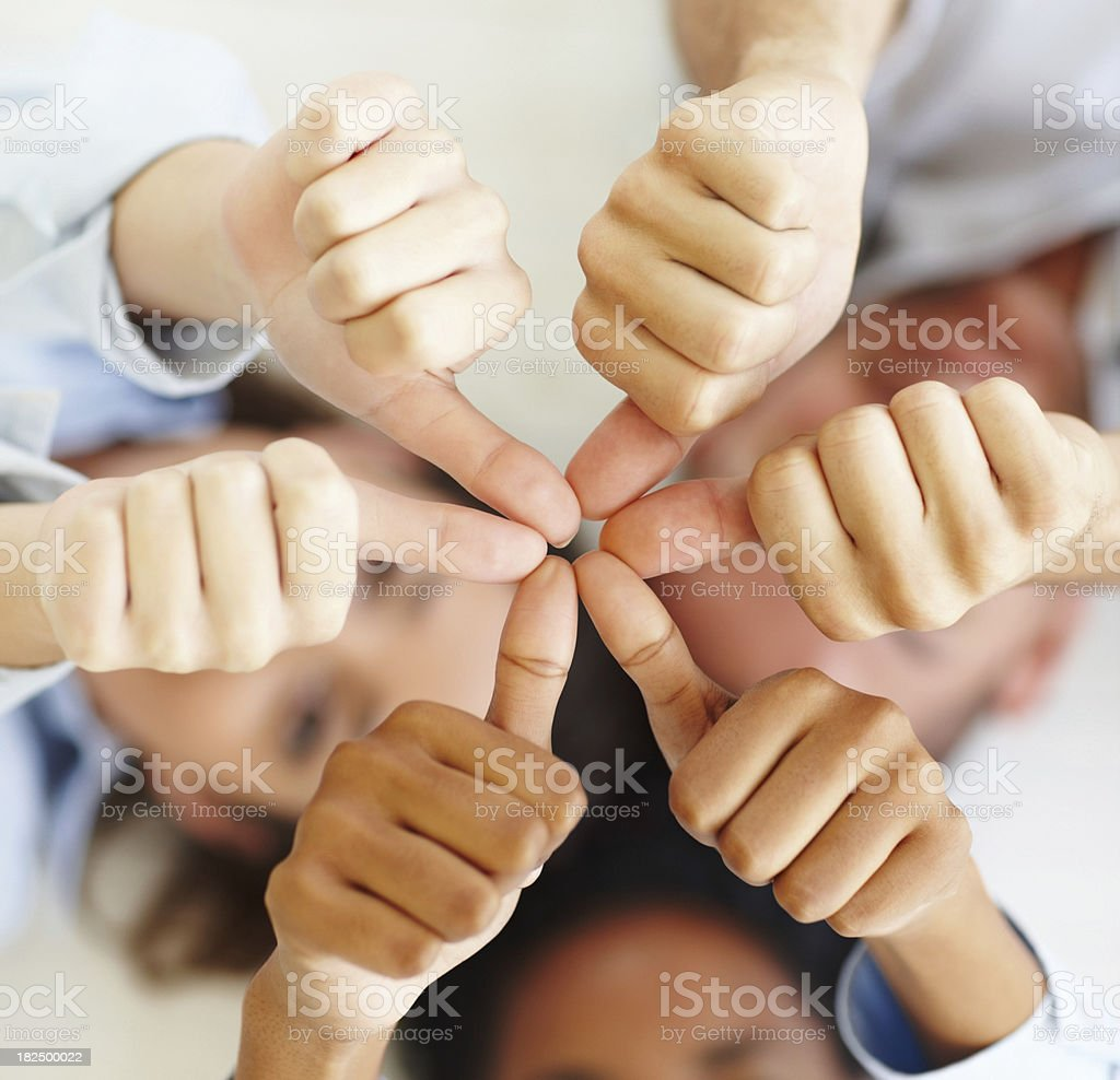 Three business colleagues showing thumbs up sign royalty-free stock photo