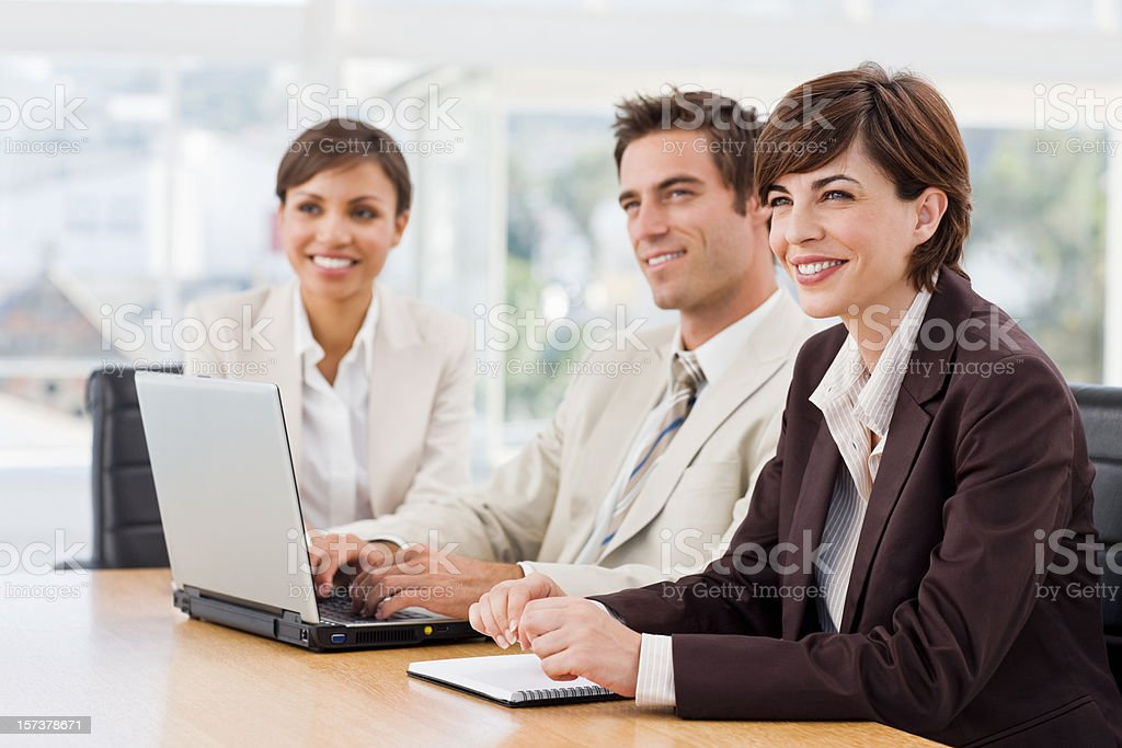 Three business colleagues sitting together royalty-free stock photo