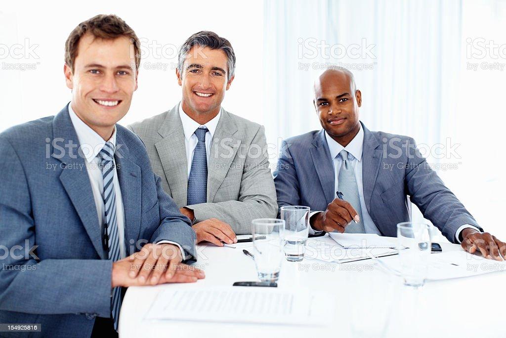 Three business men smiling royalty-free stock photo