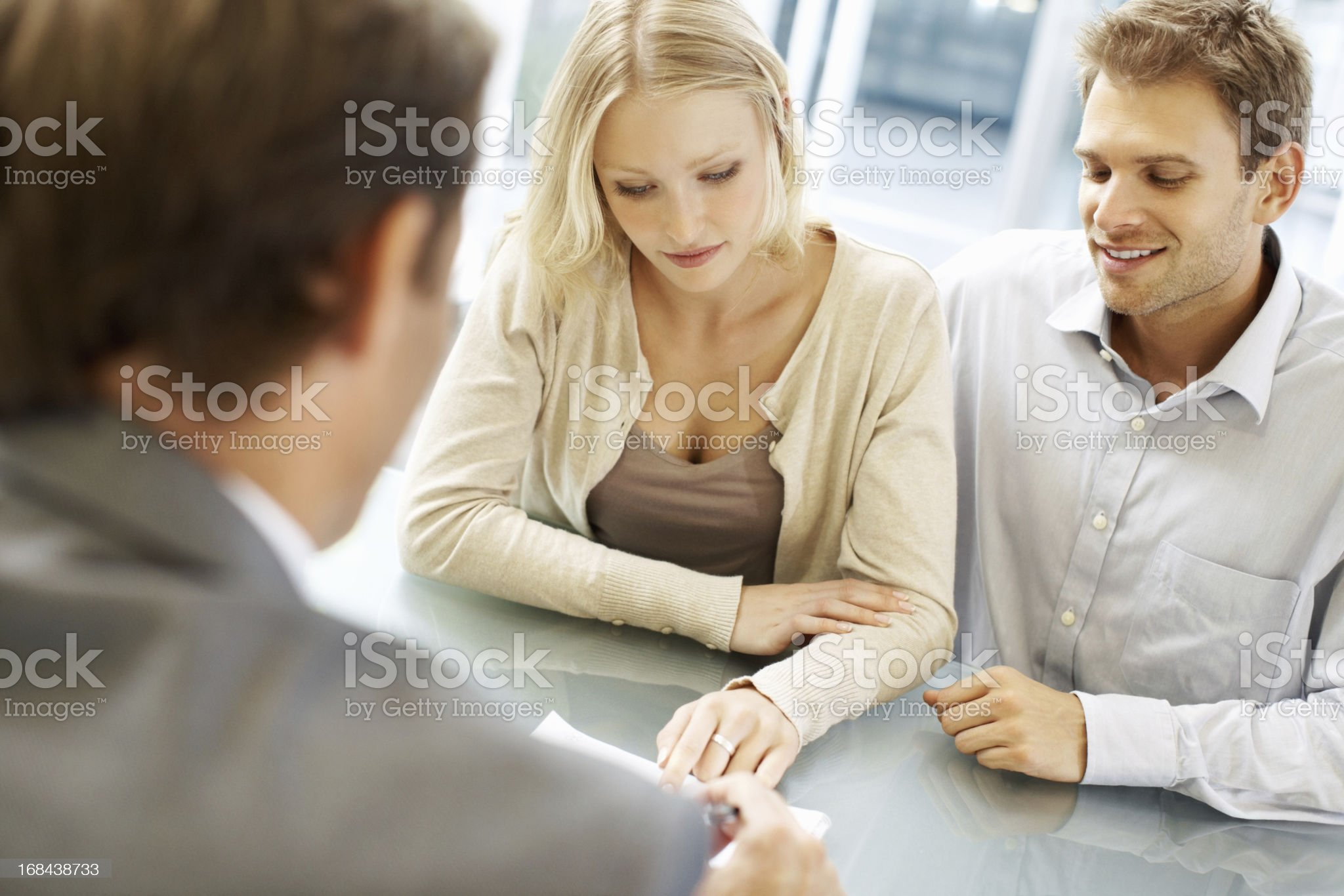 Three business people discussing in a meeting royalty-free stock photo