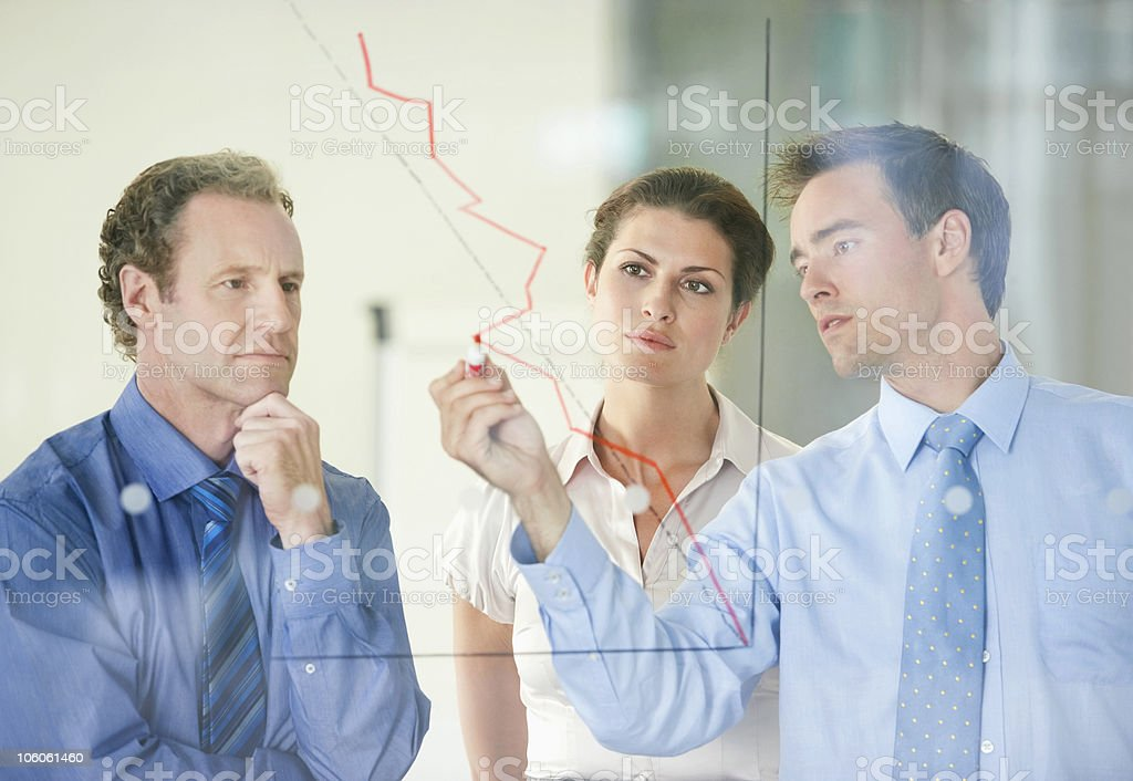 Three business people having a meeting on business development stock photo