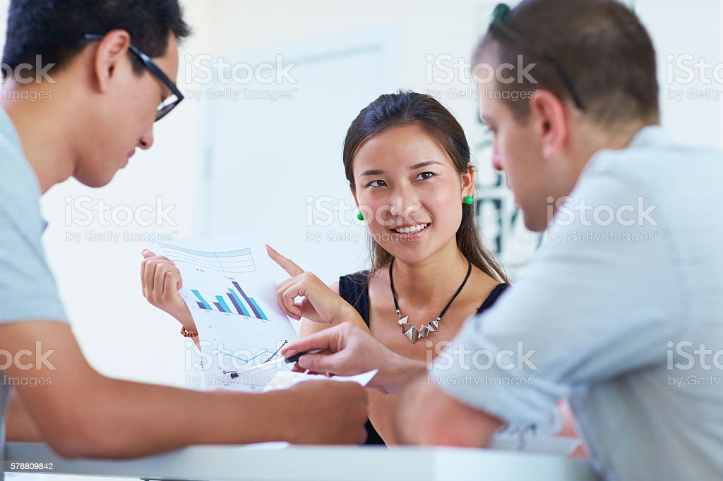 three business people having meeting together stock photo