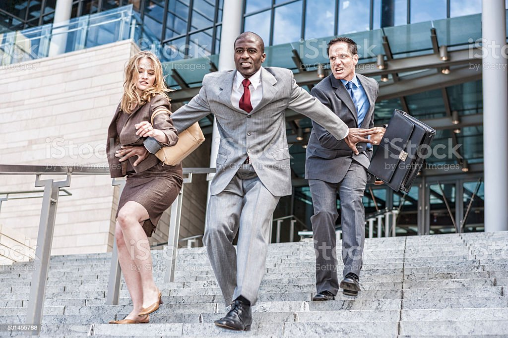 Three Business People Racing to See Who Will be First stock photo