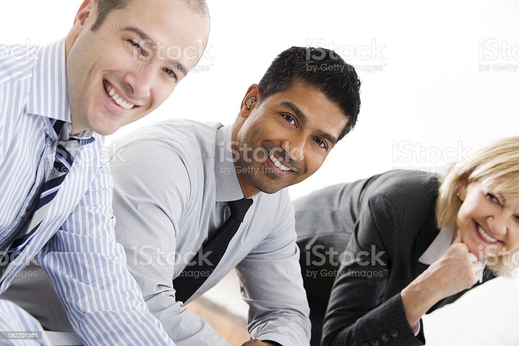 Three Business people Sitting at a Table royalty-free stock photo