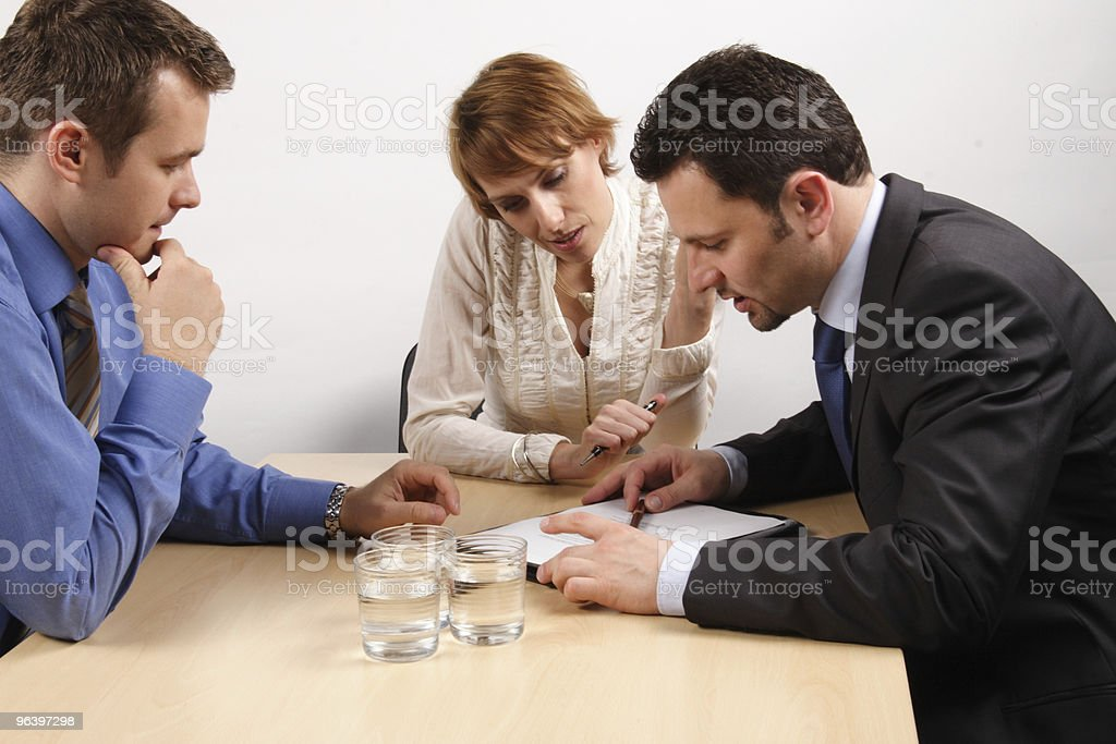 three business people talking about contract royalty-free stock photo