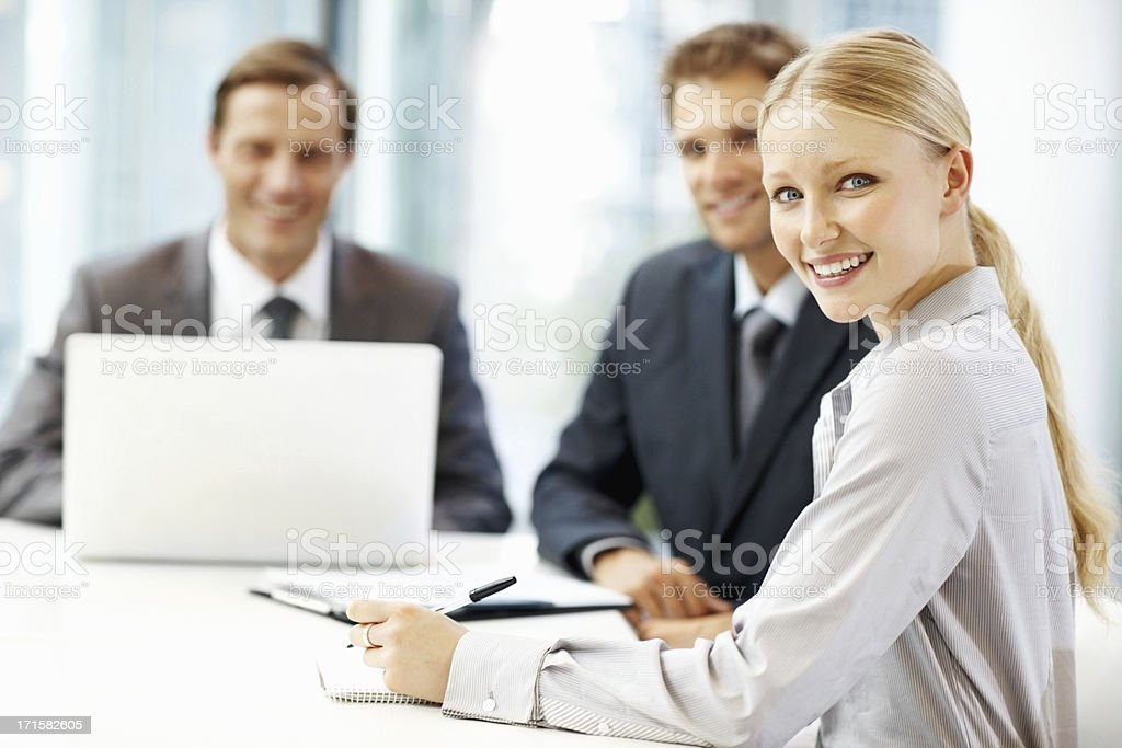 Three business people working together in a meeting royalty-free stock photo