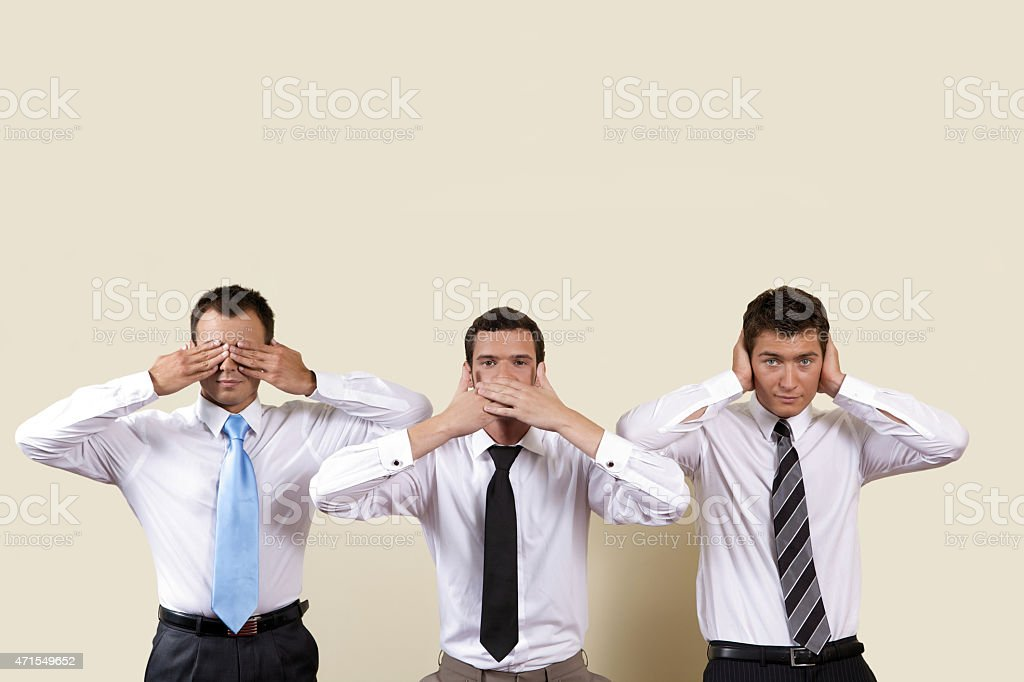 Three businessman covering eyes, mouth and ears stock photo