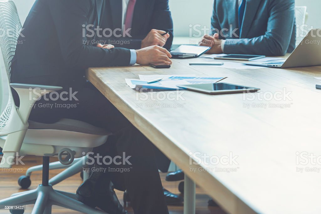 Three businessmen in a meeting. stock photo
