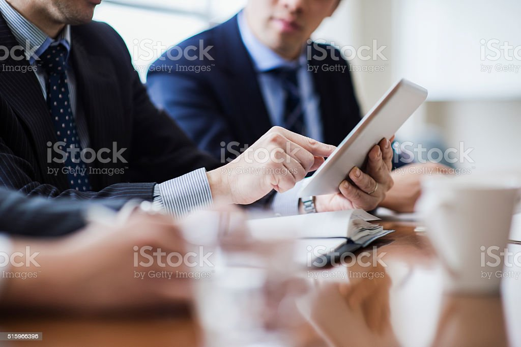 Three businessmen meeting in a conference room. stock photo
