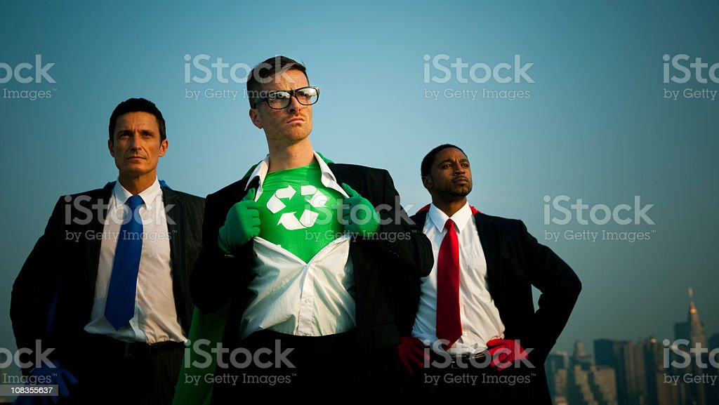 Three businessmen, one displaying his green recycling shirt stock photo