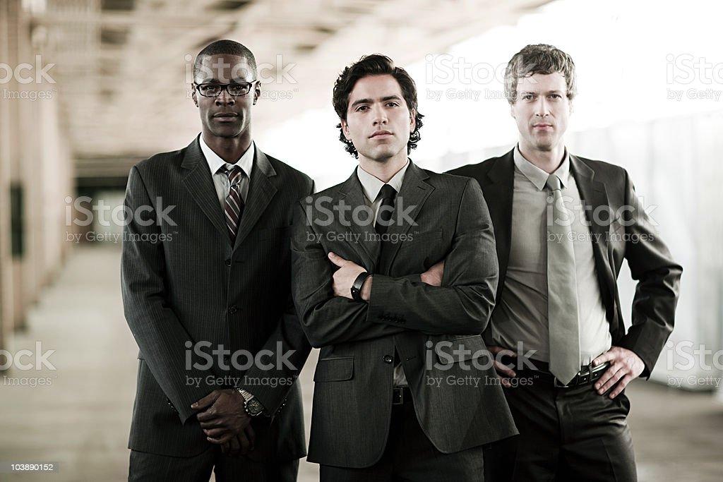 Three businessmen stock photo