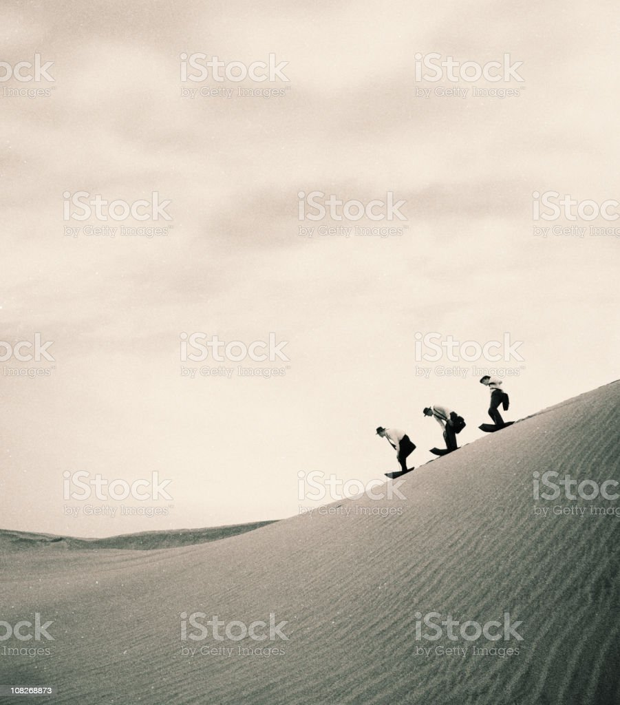 Three Businessmen Playing on Sand Dune royalty-free stock photo