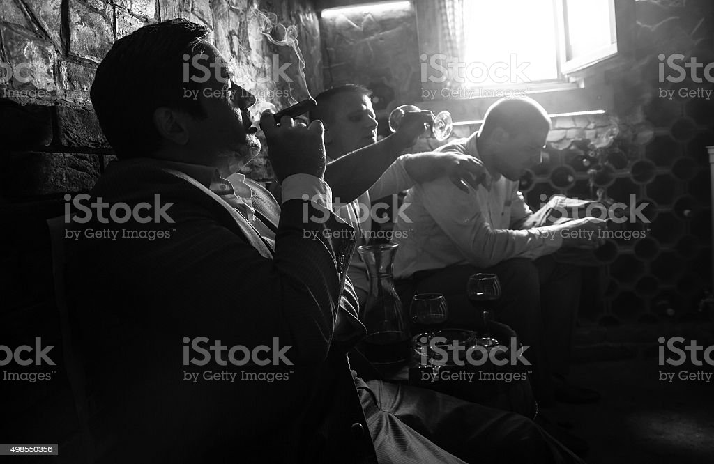 Three businessmen resting after a hard day at work. stock photo