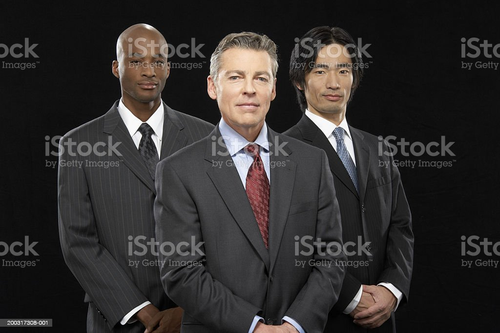 Three businessmen standing together, smiling, portrait royalty-free stock photo
