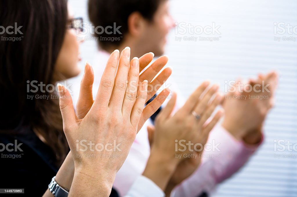 Three businesspeople giving applause royalty-free stock photo