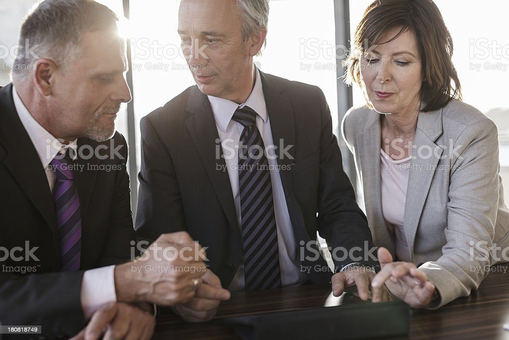 Three Businesspeople in a business meeting royalty-free stock photo