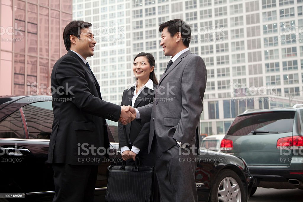 Three businesspeople outdoors royalty-free stock photo