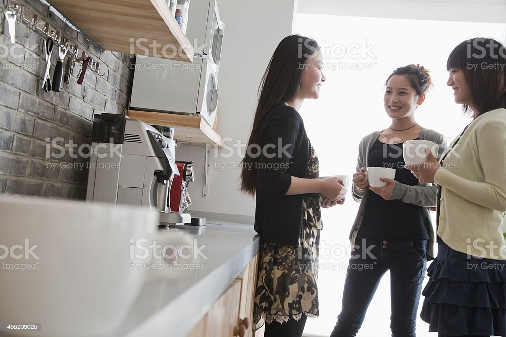 Three businesswomen on the coffee break in office stock photo