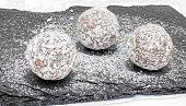 Three butter truffles on a black stone slab
