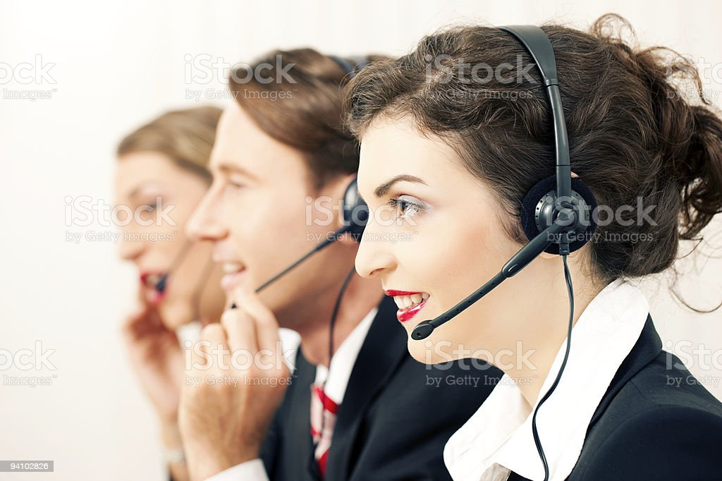 Three call center agents at work royalty-free stock photo