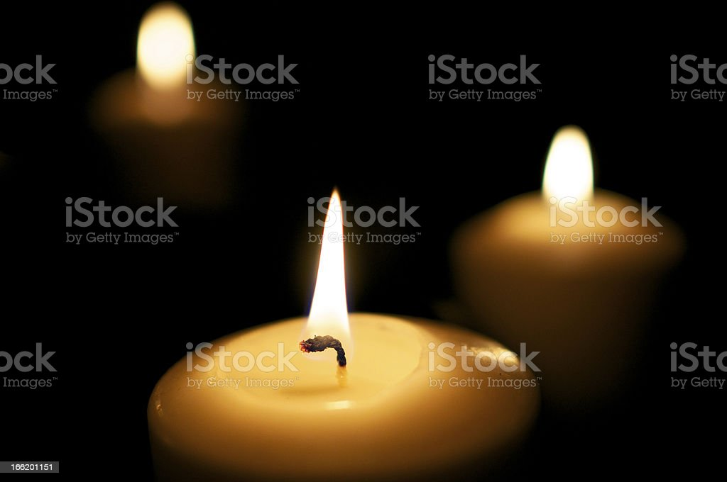 Three candles burn in the night royalty-free stock photo