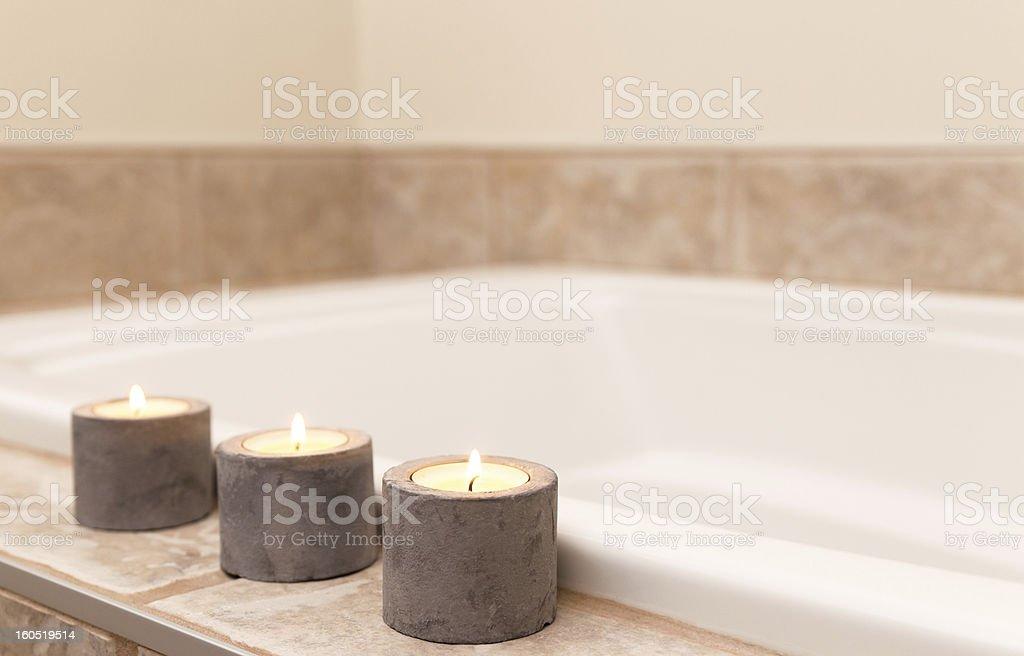 Three candles decorating bathroom royalty-free stock photo