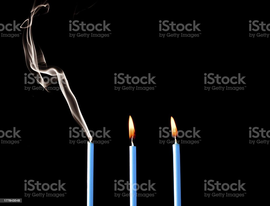 Three Candles Lit and Smoking royalty-free stock photo