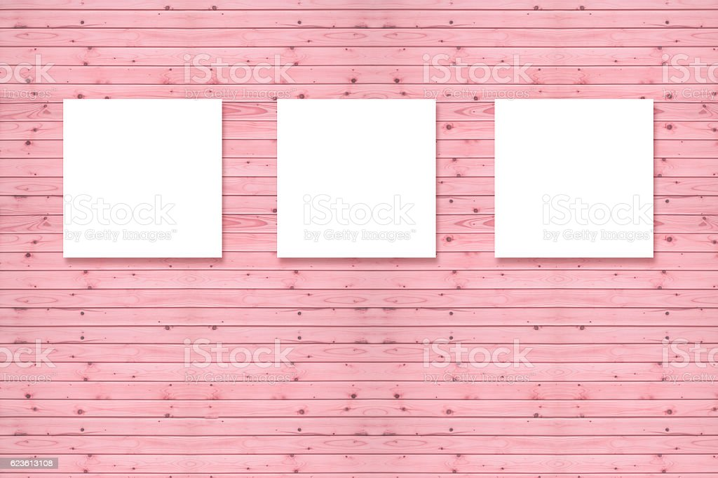 Three canvas frame on pine wooden wall,pink pastel color stock photo