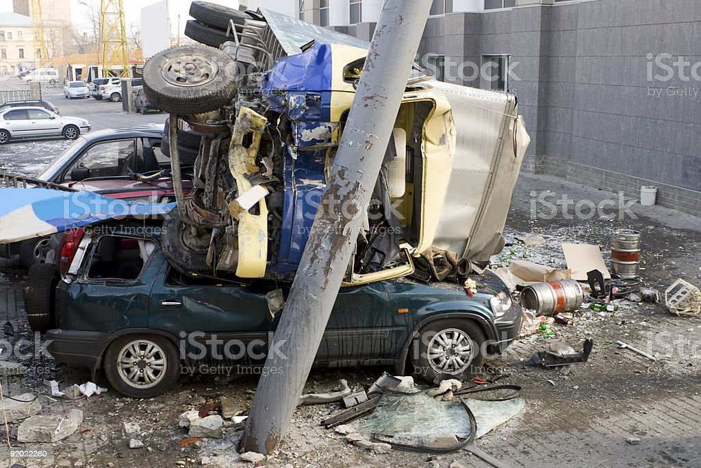A three car crash scene with one car on top the other two  stock photo