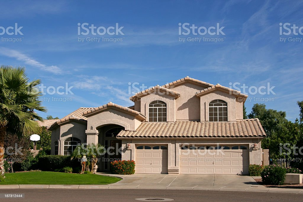 Three Car Garage House in Southwest royalty-free stock photo